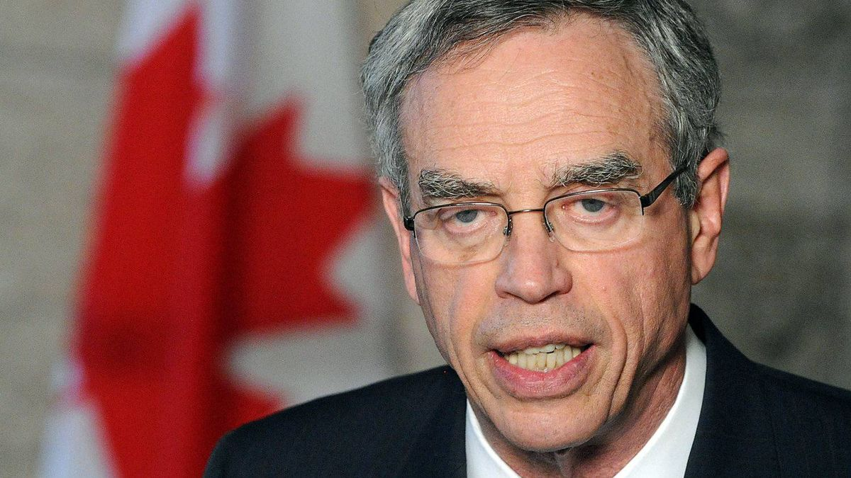 Natural Resources Minister Joe Oliver speaks to reporters in the foyer of the House of Commons on May 7, 2012.