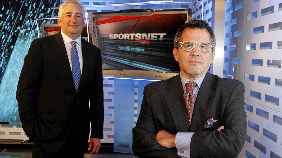 Rogers executives Dale Hooper, left, and Dean Bender with the new logo for Sportsnet