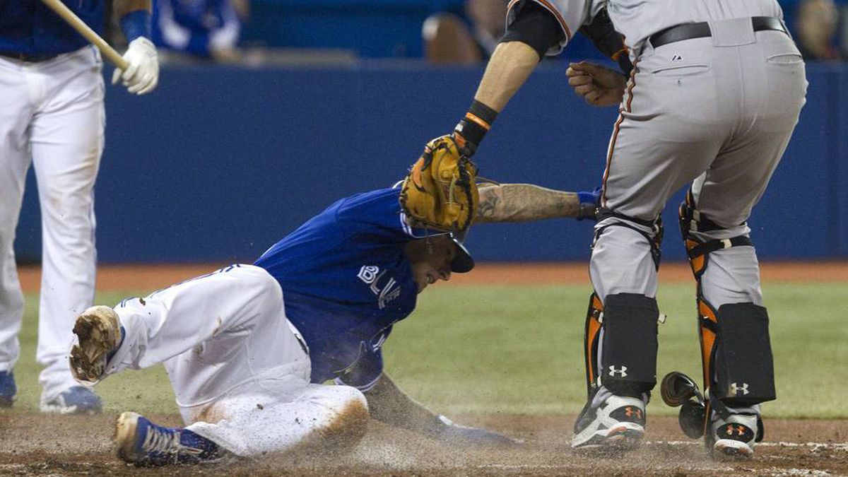 Baltimore Orioles catcher Matt Wieters, right, puts the tag on Toronto Blue Jays Brett Lawrie for the out trying to steal home in the second inning of their game in Toronto on Sunday.