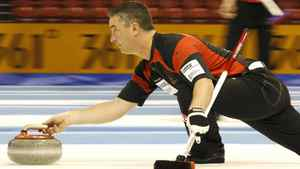 Canada vice-skip Wayne Middaugh delivers his stone during play against New Zealand at the World Men's Curling Championship 2012 in Basel April 5, 2012. REUTERS/Arnd Wiegmann