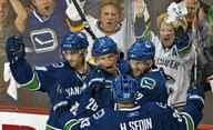 Vancouver Canucks' Mikael Samuelsson (C) celebrates his goal against the Los Angeles Kings with teammates Daniel Sedin (R), Henrik Sedin and Pavol Demitra during the second period of Game 1 of their NHL Western Conference quarter-final hockey game in Vancouver.