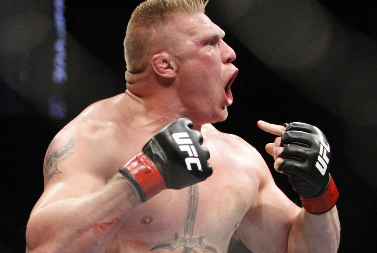 Brock Lesnar celebrates after defeating Frank Mir in their heavyweight title bout at UFC 100 at Mandalay Bay in Las Vegas Saturday, July 11, 2009. (AP Photo/Las Vegas Review-Journal, John Locher)