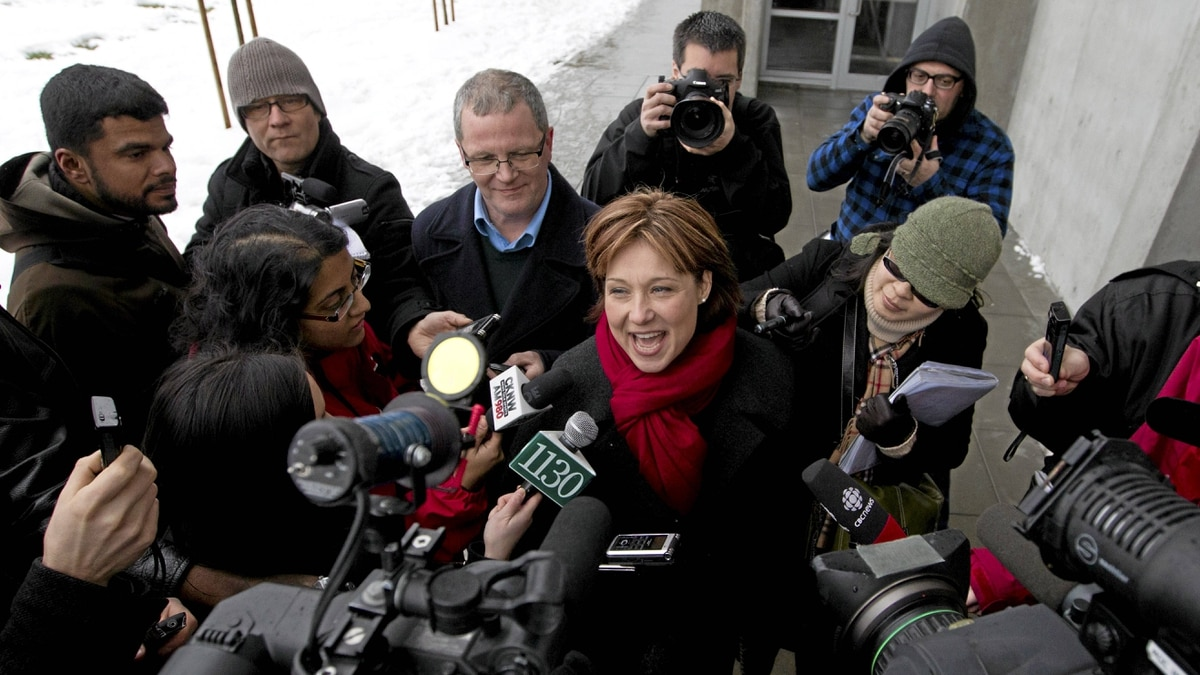 Premier designate Christy Clark is scrummed by the media after winning the Liberal Leadership election.