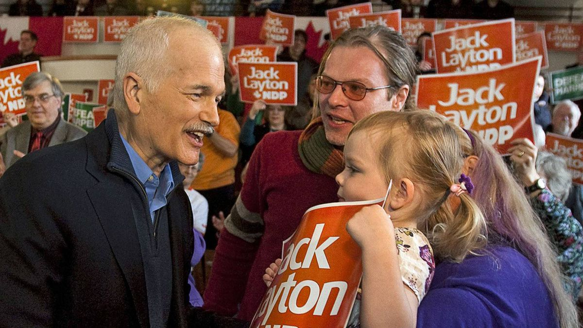 NDP Leader Jack Layton is greeted by 3-year-old Ophelia McDaid as he meets supporters during a campaign stop in Regina on March 28, 2011.