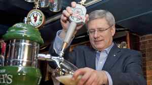 Prime Minister Stephen Harper pours pints of beer during a campaign stop at a Halifax tavern on March 31, 2011.