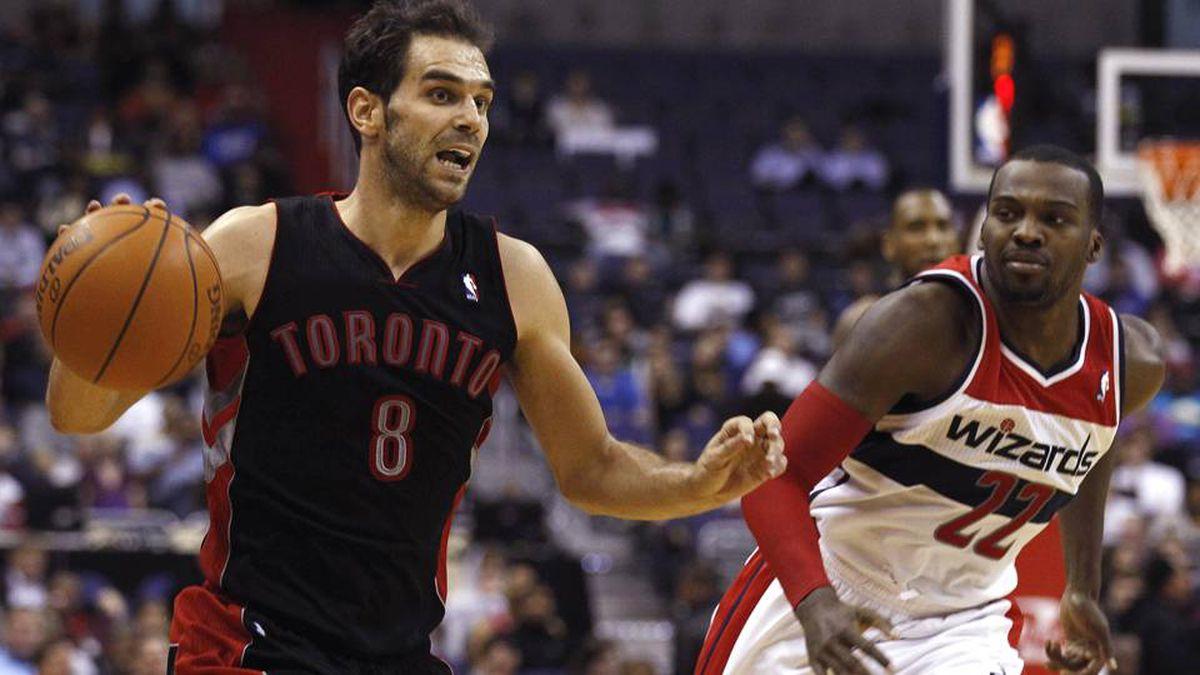 Toronto Raptors' Jose Calderon controls the ball as Washington Wizards' Shelvin Mack during the first half of their NBA game in Washington.