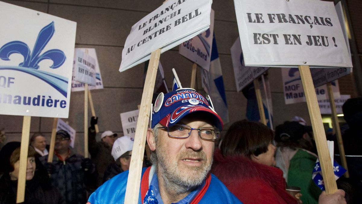 Pro-French language protesters rally outside the Bell Centre in Montreal, Saturday, January 7, 2012, during a demonstration denouncing the recent appointment of a unilingual head coach of the Montreal Canadiens hockey team. CANADIAN PRESS/Graham Hughes