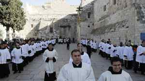 Clergy gather in Manger Square outside the Church of the Nativity while Christians gather for Christmas celebrations in the West Bank city of Bethlehem, on December 24, 2011. Thousands of Christian pilgrims descended on on the holy city to celebrate in Jesus' traditional birthplace.