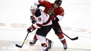 The Ottawa Senators' Zenon Konopka hits the New Jersey Devils' Zach Parise in Ottawa, March 20, 2012.