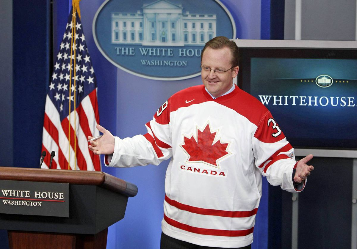 White House press secretary Robert Gibbs wears a Team Canada jersey at a news briefing in Washington on March 12, 2010.