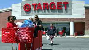 Shoppers come out from the Target store in Boston in this file photo.