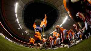 B.C Lions players take to the field after the roof was opened at the renovated B.C. Place stadium before the Lions and Edmonton Eskimos CFL football game in Vancouver, B.C., on Friday September 30, 2011.