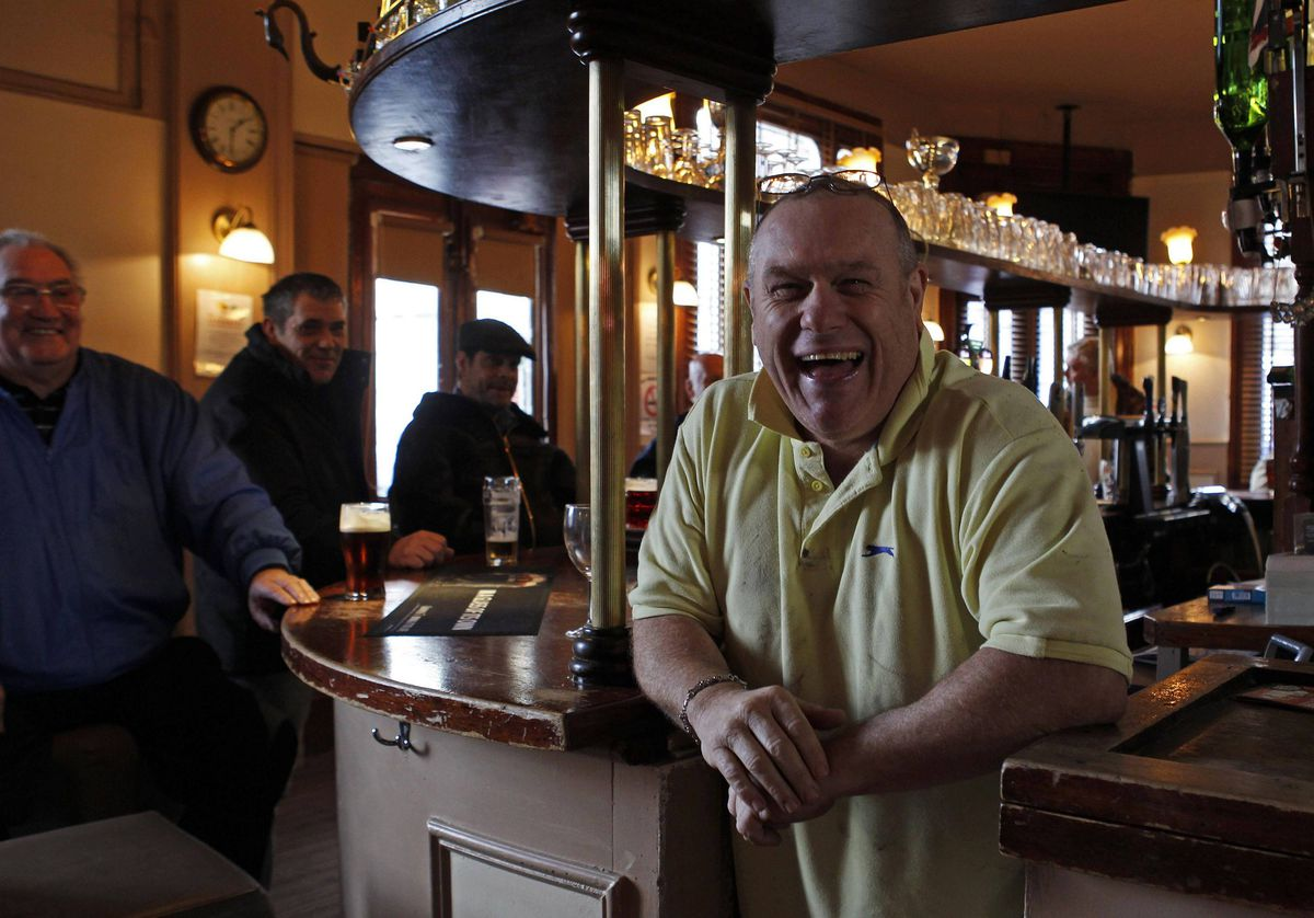 Landlord Keith Martin poses for a photograph at the Lord Cardigan pub in east London.