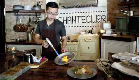Jonathan Poon, chef and co-owner of Chantecler restaurant in Toronto, prepares seared and torched makerel with celeriac, apple and rhubarb remoulade and rye crisp