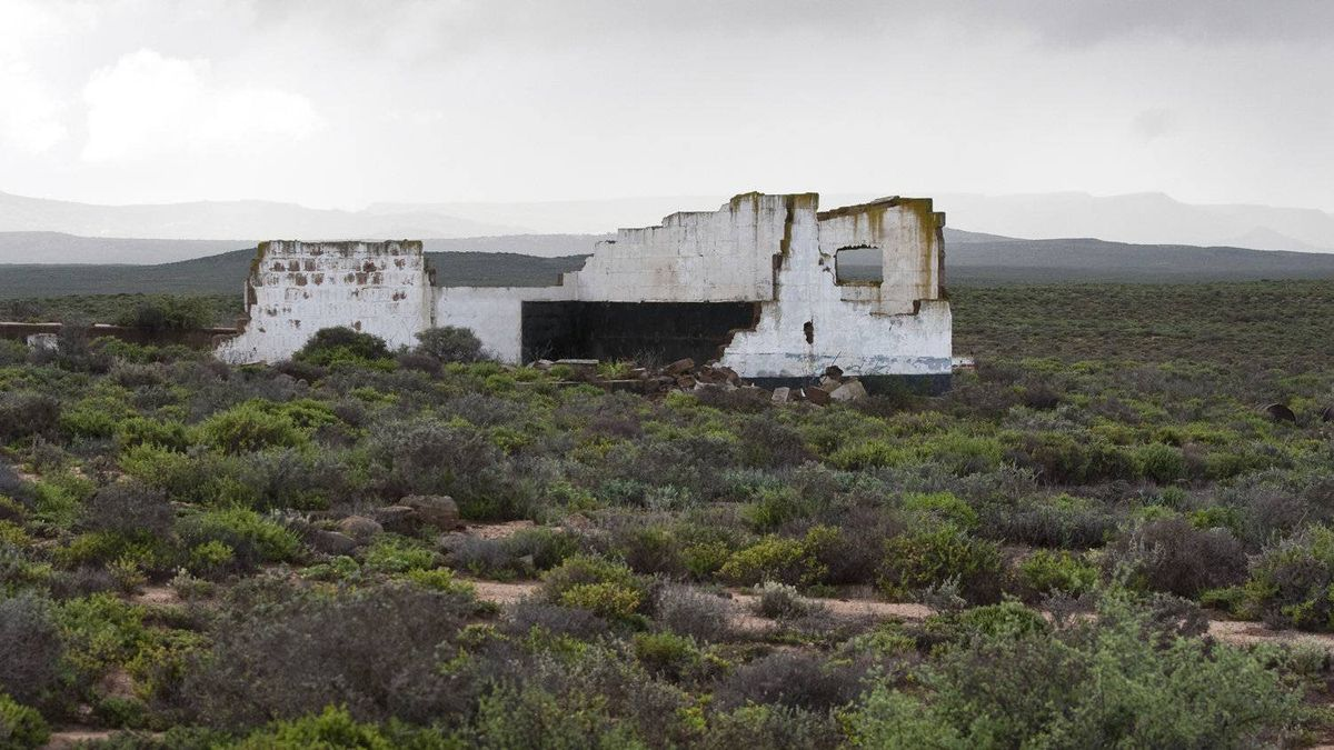 The ruins of an old hostel for workers at Steenkampskraal mine, located in a remote corner of South Africa's Western Cape province. The mine was abandoned in 1963 and is now being turned into a rare earths mine.