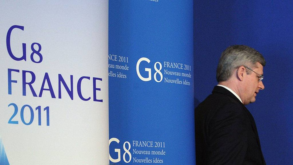 Prime Minister Stephen Harper takes part in a closing press conference following the G8 Summit in Deauville, France on Friday, May 27, 2011.