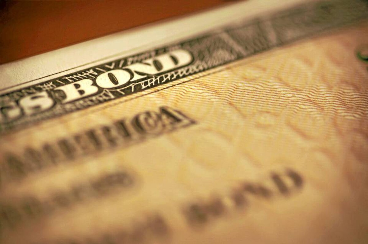 Closeup of a U.S. savings bond: Some interest rates have been falling in the past few weeks because investors are flocking to the safety of U.S. and Canadian government bonds.