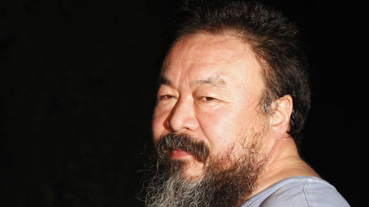 Dissident Chinese artist Ai Weiwei stands in the entrance of his studio after being released on bail in Beijing June 23, 2011.