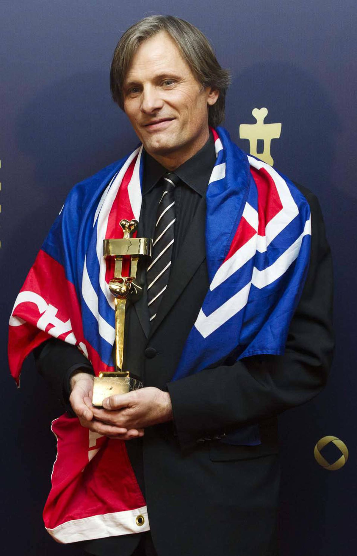 Later, Viggo Mortensen could barely contain his joy as he posed with the Genie for best supporting actor at the Genie Awards in Toronto last week.