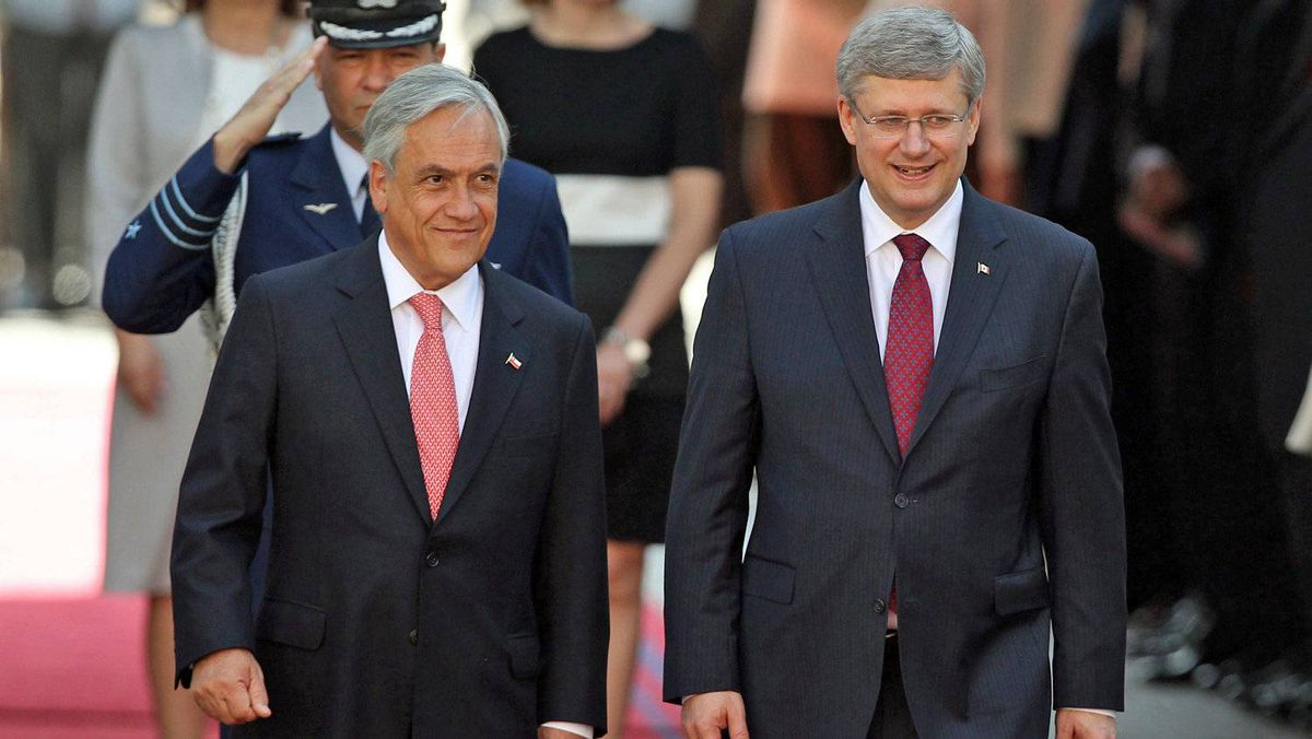 Chilean President Sebastian Pinera welcomes Prime Minister Stephen Harper to the government palace in Santiago on April 16, 2012.
