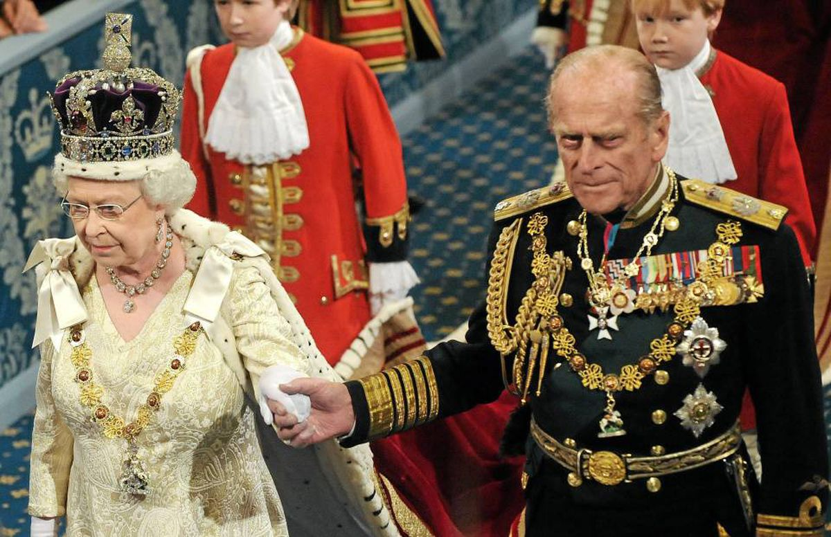 Britain's Queen Elizabeth and Prince Philip walk through the Royal Gallery in Westminster.