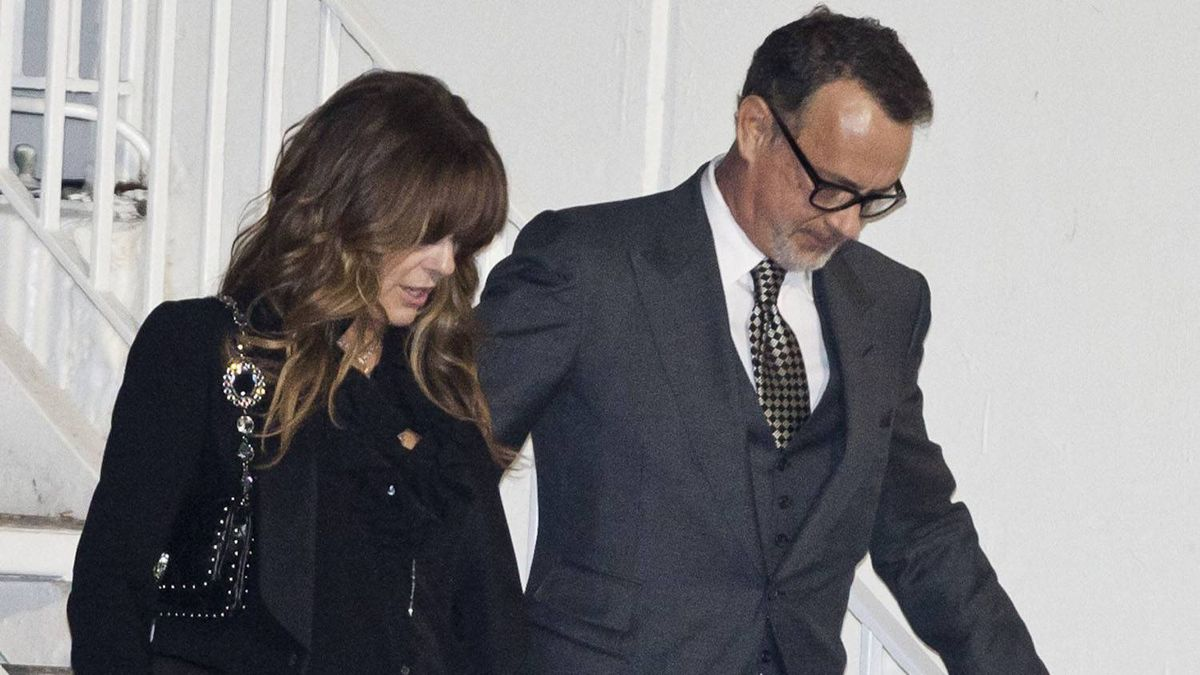 Actor Tom Hanks and his wife Rita Wilson leave the Pre-GRAMMY Gala at the backdoor of the Beverly Hills Hilton hotel in Beverly Hills, Calif. Saturday, Feb. 11, 2012. Whitney Houston was pronounced dead at 3:55 p.m. in her room on the fourth floor of the hotel on Saturday. She was 48.