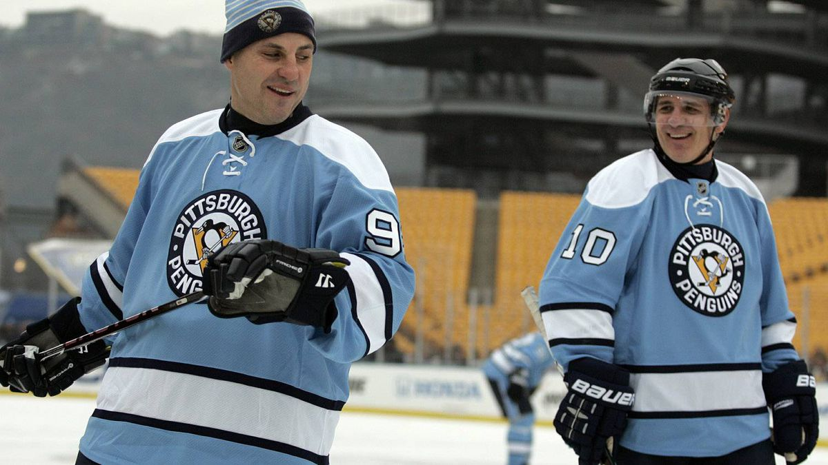 Rick Tocchet #92 and Ron Francis #10 of the Pittsburgh Penguins have a laugh during the 2011 NHL Winter Classic Alumni Game on December 31, 2010 at Heinz Field in Pittsburgh, Pennsylvania. (Photo by Justin K. Aller/Getty Images)