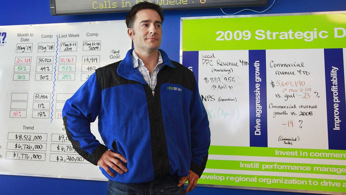 Brian Scudamore, founder and CEO of 1-800-GOT-JUNK, leads a group rally in the lunchroom of company offices in downtown Vancouver May 22, 2009.