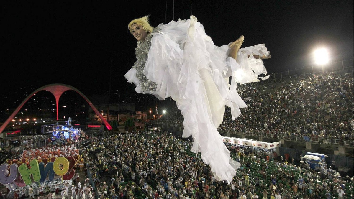 A reveler of the Porto da Pedra samba school is suspended from a balloon during the second night of the annual Carnival parade.
