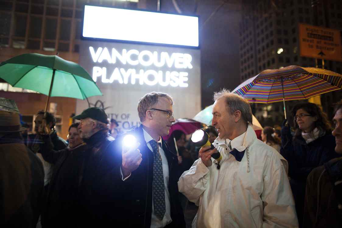 Supporters, actors and theatre students gather during a flashlight vigil outside the Vancouver Playhouse on the closing night in Vancouver, Saturday, March 10, 2012.
