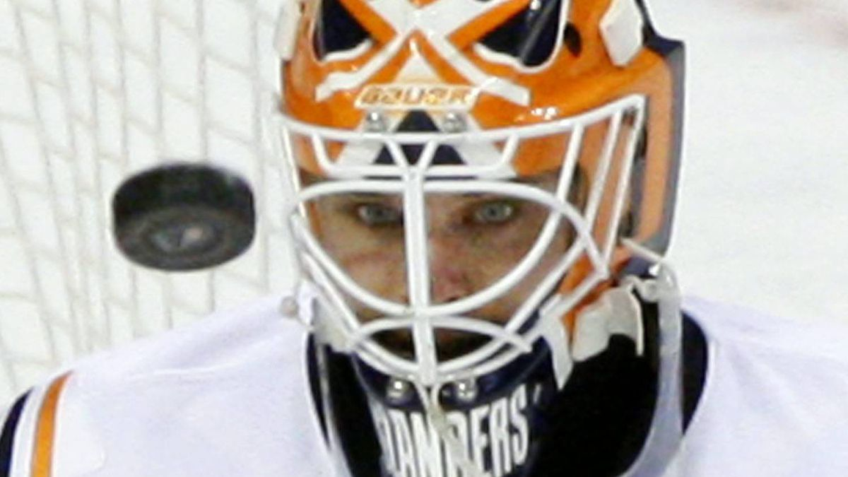 This This Dec. 8, 2009, file photo shows New York Islanders goalie Martin Biron watching the puck shot by Philadelphia Flyers' Jeff Carter in the third period of an NHL hockey game, in Philadelphia. Veteran goalie Martin Biron signed a two-year deal with the New York Rangers on Thursday, July 1, 2010, less than one hour into the NHL's free-agent shopping season. (AP Photo/Matt Slocum, File)