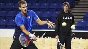 Team Canada Davis Cup member Vasek Pospisil returns a shot as coach Martin Laurendeau looks on during a training session at the University of B.C. on Feb. 6, 2012.
