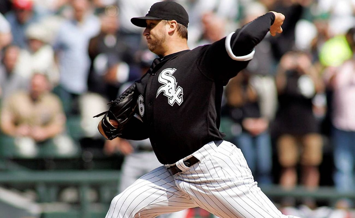 Chicago White Sox starting pitcher Mark Buehrle throws to Cleveland Indians leadoff hitter Asdrubal Cabrera in the first inning of their MLB American League opening day baseball game in Chicago.