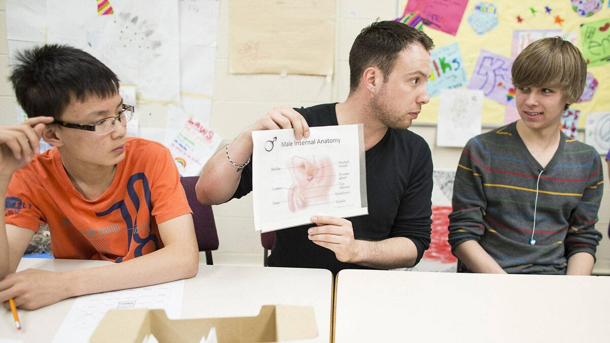 Blake Spence, centre, co-ordinates the WiseGuyz Program, now on offer to Grade 9 boys in two Calgary schools.