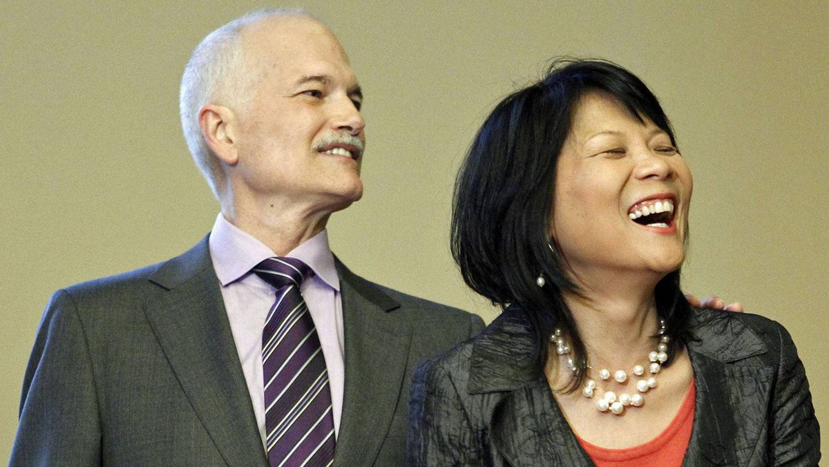 NDP Leader Jack Layton and his wife, Toronto MP Olivia Chow, wait to be sworn in again in Ottawa after their re-election on May 18, 2011.