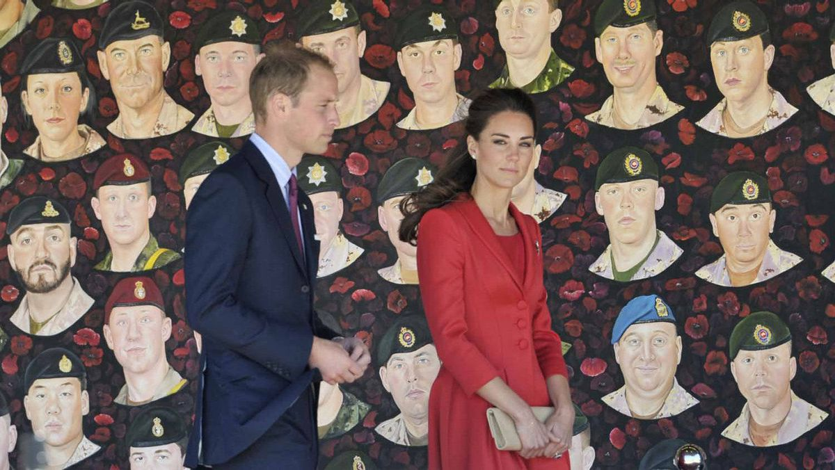 The Duke and Duchess of Cambridge view the Portraits of Honour display at their official departure ceremony in Calgary, Friday July 8, 2011.