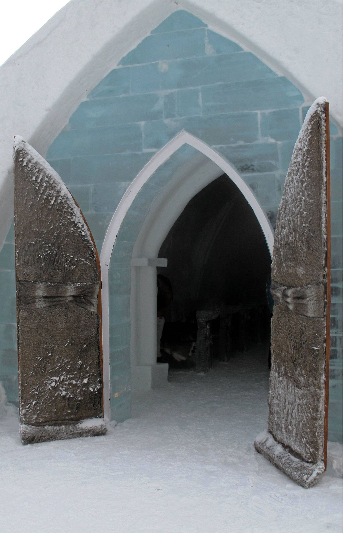 Going to the chapel and we're going to get married... Designers in Quebec City are fashioning bridal gowns specifically for ice hotel weddings. Fur stoles are a must.