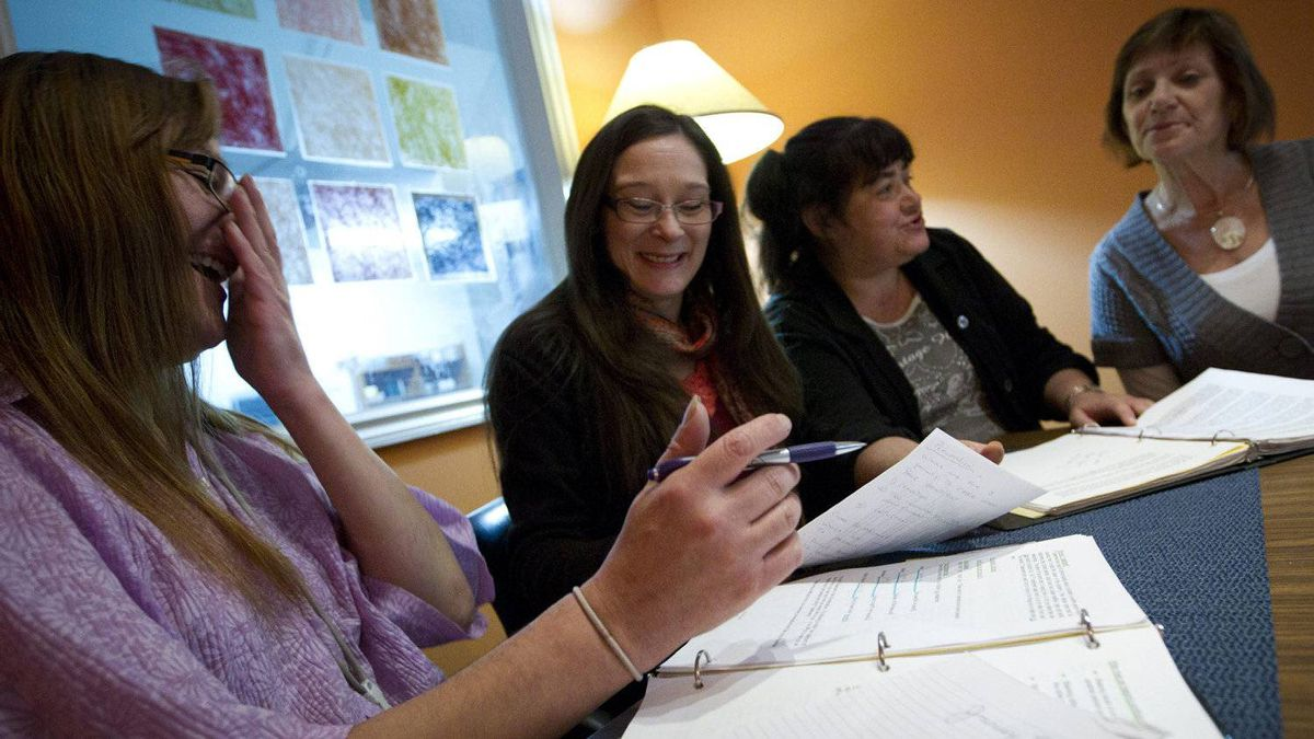 Kerry Porth (second from left), a former sex worker, is spokesperson for PACE seen here at her office in Vancouver November 15, 2011 during a meeting with her colleagues also former sex workers.