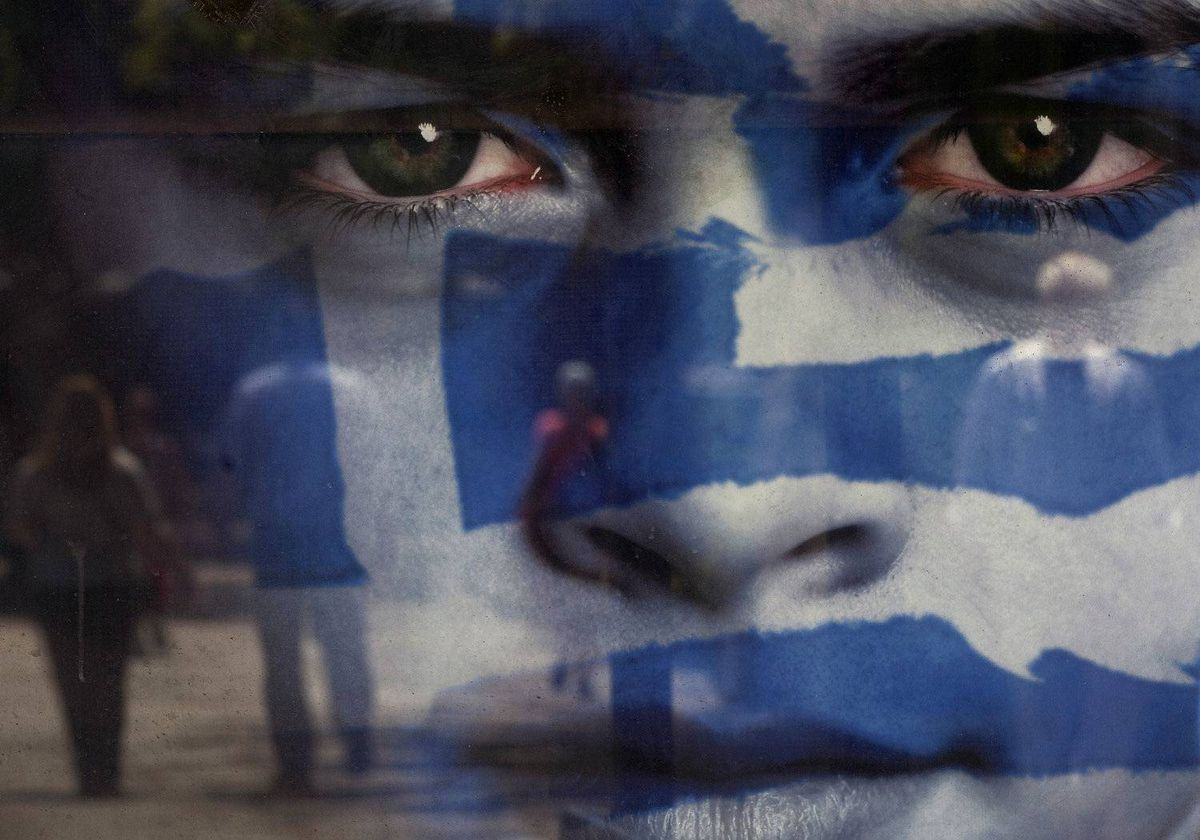 Pedestrians are reflected in a poster advertising the Greek national elections, on the day of voting in Athens, Greece, on Sunday, May 6, 2012.