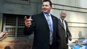 Former Major League Baseball pitcher Roger Clemens signs autographs while leaving the E. Barrett Prettyman United States Court House as his retrial continues on charges that Clemens committed perjury when he told Congress in 2008 that he had never taken steroids or human growth hormone, Thursday, May 3, 2012, in Washington. (AP Photo/Jacquelyn Martin)