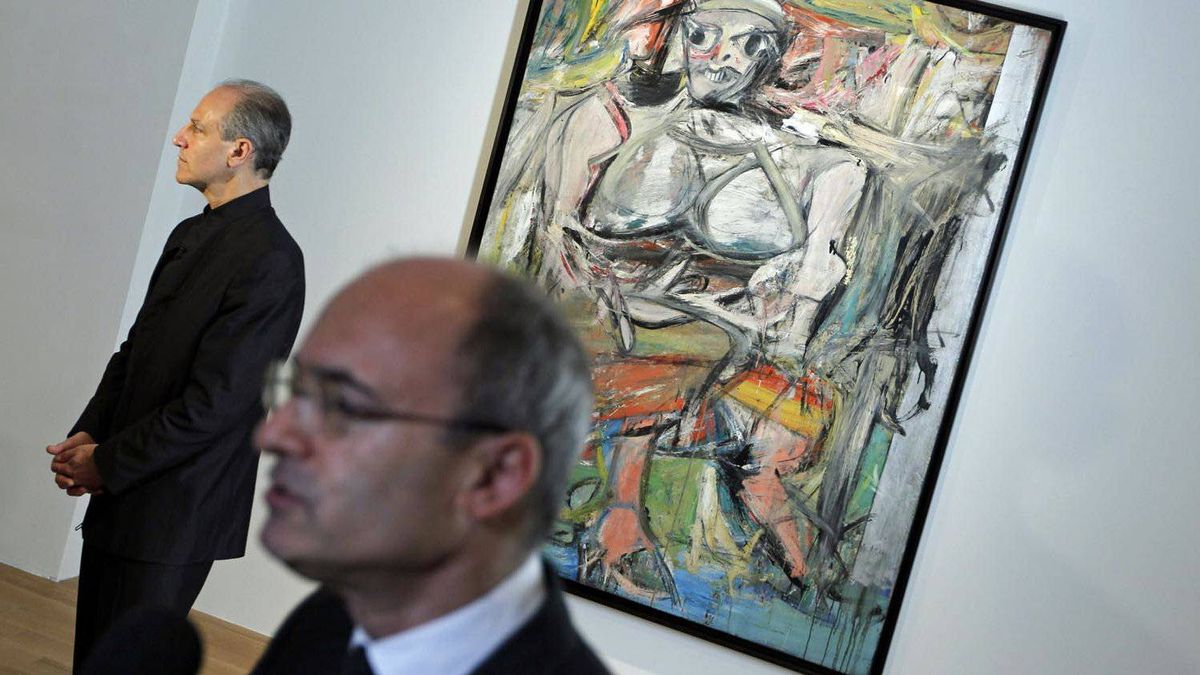 The iconic modern art painting by de Kooning, Woman #1 was uncrated and hung at the Art Gallery of Ontario on May13, 2011. AGO director Matthew Teitelbaum, foreground, and Glenn Lowry, director of the Museum of Modern Art, were both on hand for the event.
