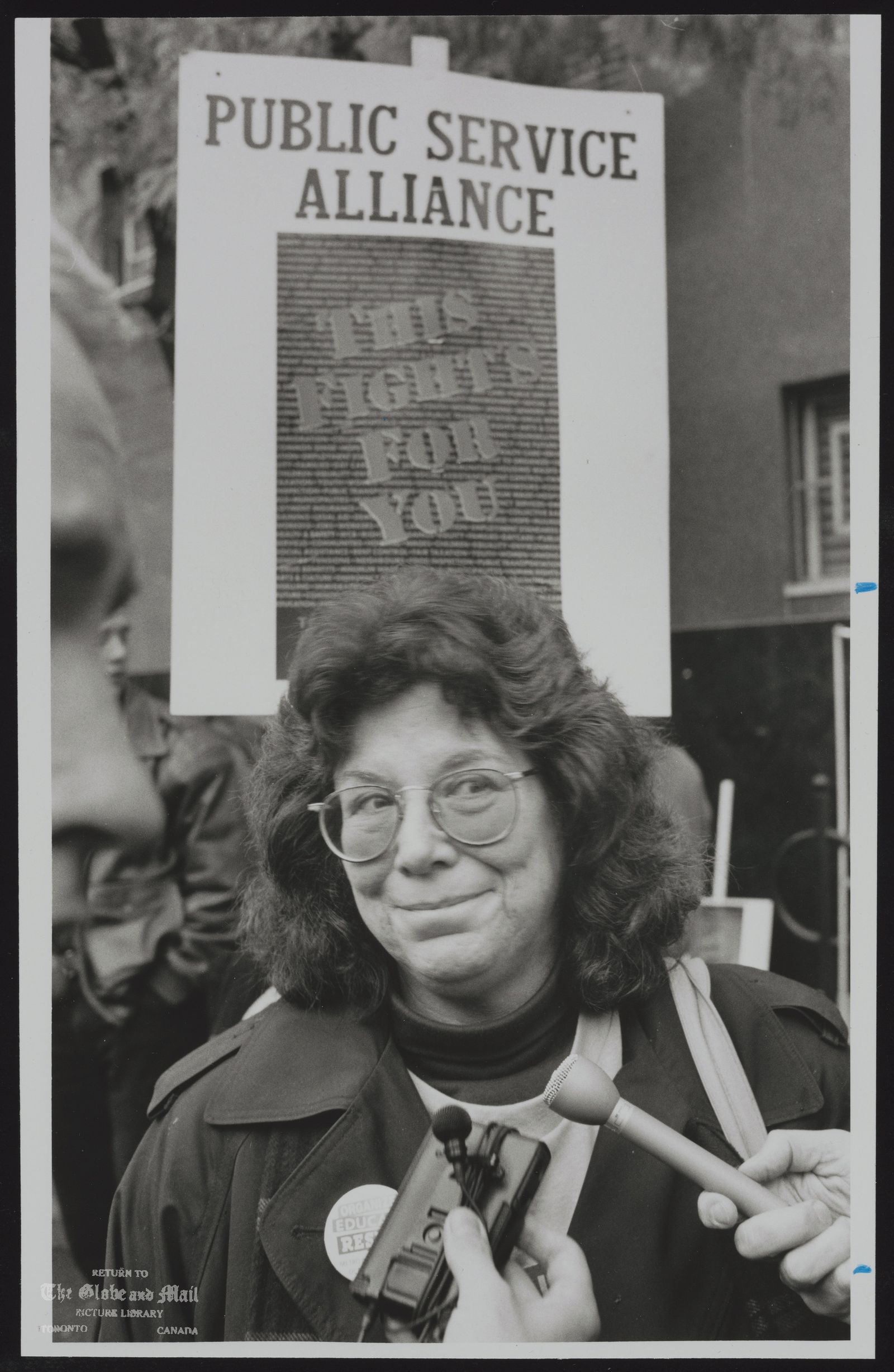 The notes transcribed from the back of this photograph are as follows: TORNEY SPEAKS AT A RALLY IN TORONTO, A WARNING FOR THE DAYS OF ACTION PROTEST.