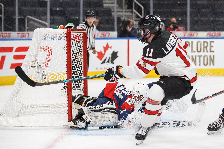 Alexis Lafrenière nursing an ankle injury at Canada's world junior ...
