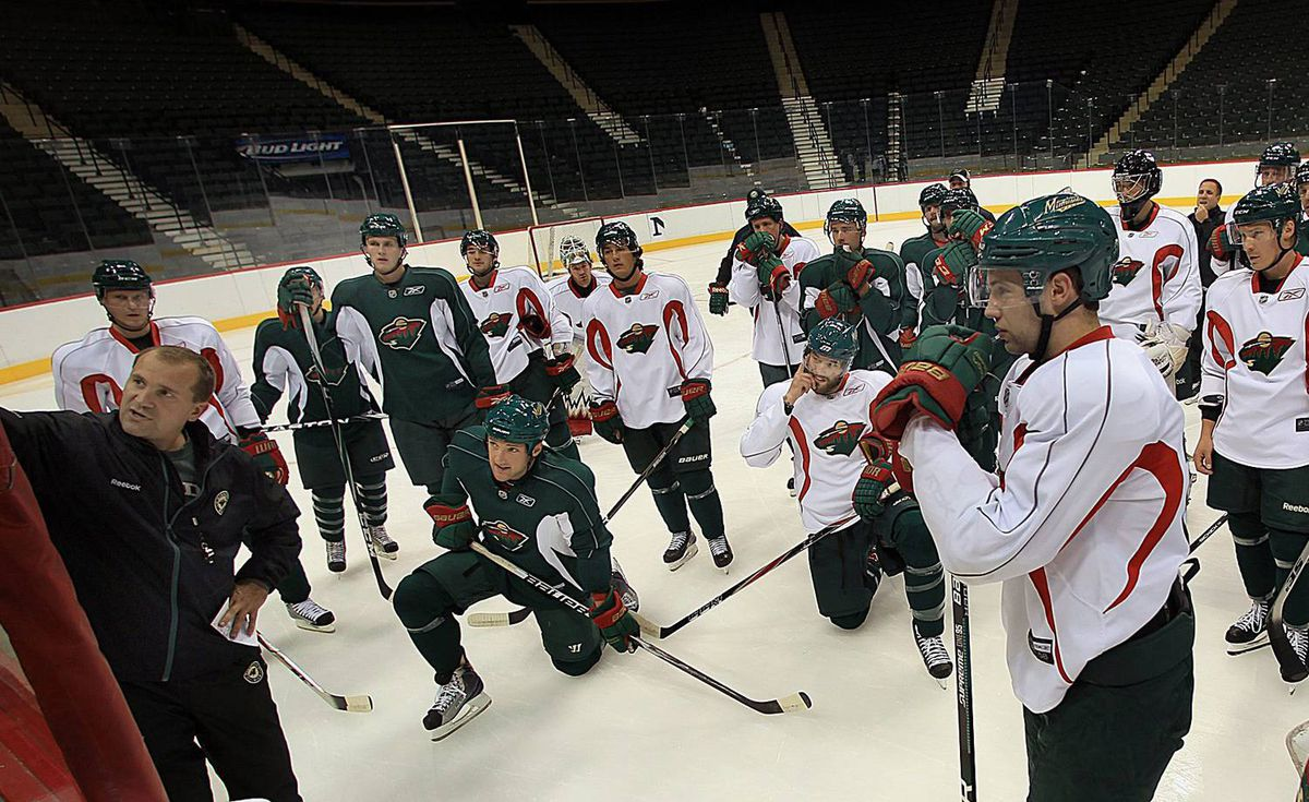 Minnesota Wild head coach Todd Richards gives instructions to the players at the first training camp practice Saturday Sept. 18, 2010. The Wild held its first practice as part of the teams annual training camp at the Xcel Energy Center. Players and coaches went through drills and discussed various on-ice strategies. (AP Photo/ Star-Tribune, Jime Gehrz)