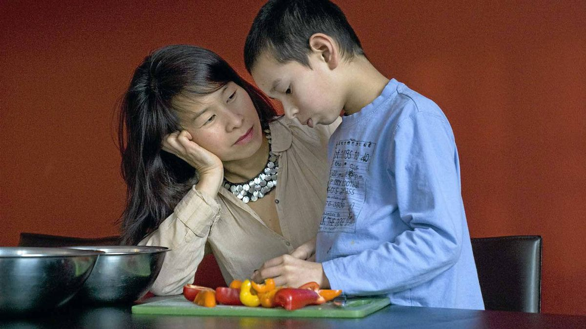 Author Kim Thuy prepares dinner with her son Valmond at her home in Longueuil, Que., on Feb. 2, 2012.