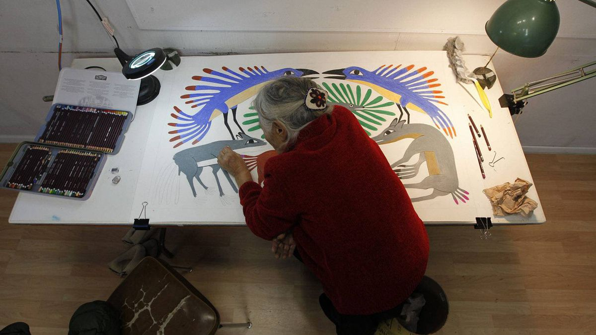 Images from Cape Dorset, Nunavut on November 8, 2022. Artist Kenoajvak Ashevak works on a new print inside the Kinngait Co-operative print shop. (Photo by Peter Power/The Globe and Mail)