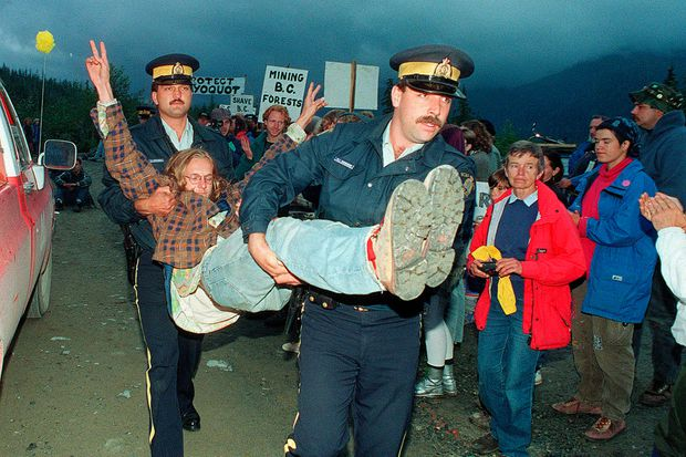 An anti-logging protester is carried away by RCMP at the entrance to Clayoquot Valley, B.C., on July 30, 1993.