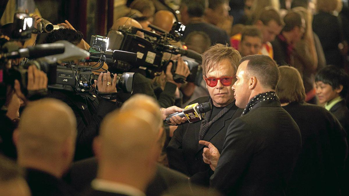 Sir Elton John and partner David Furnish make their way along the red carpet as they arrive for the opening of Billy Elliot The Musical at the Canon Theatre in Toronto.