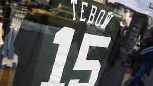"""Tim Tebow's New York Jets shirts are put up for display in New York March 23, 2012. Trading for Tim Tebow and bringing """"Tebowmania"""" to New York quickened the pulse of Jets fans in the Big Apple, which has already had a """"Linsane"""" love affair this winter with the heartwarming rise of unsung Jeremy Lin with the NBA's Knicks. REUTERS/Shannon Stapleton"""
