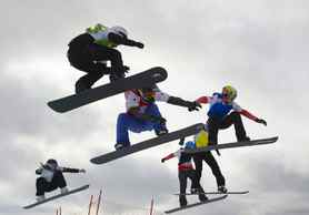 Chloe Trespeuch of France, Alexandra Jekova of Bulgaria, Lindsey Jacobellis of the United States, the winner with the red bib, Maelle Ricker of Canada, Nelly Moenne Loccoz of France and Dominique Maltais of Canada compete during the final at the women's snowboard cross World Cup race in Veysonnaz, Switzerland.